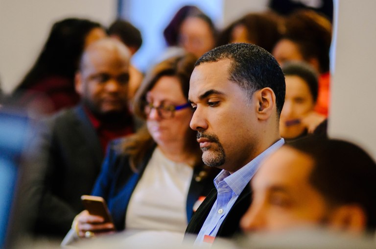 Abe Fernadez of South Bronx Rising Together listens to opening remarks at Kinvolved's Summer Summit NYC